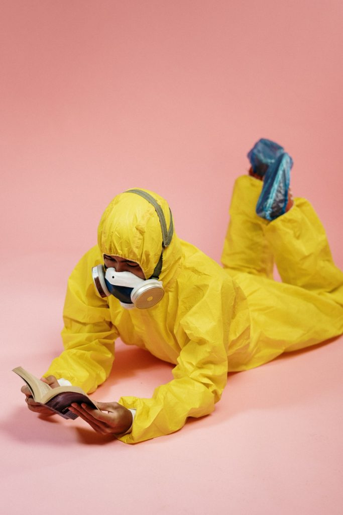 person-in-yellow-coveralls-reading-a-book-3951365