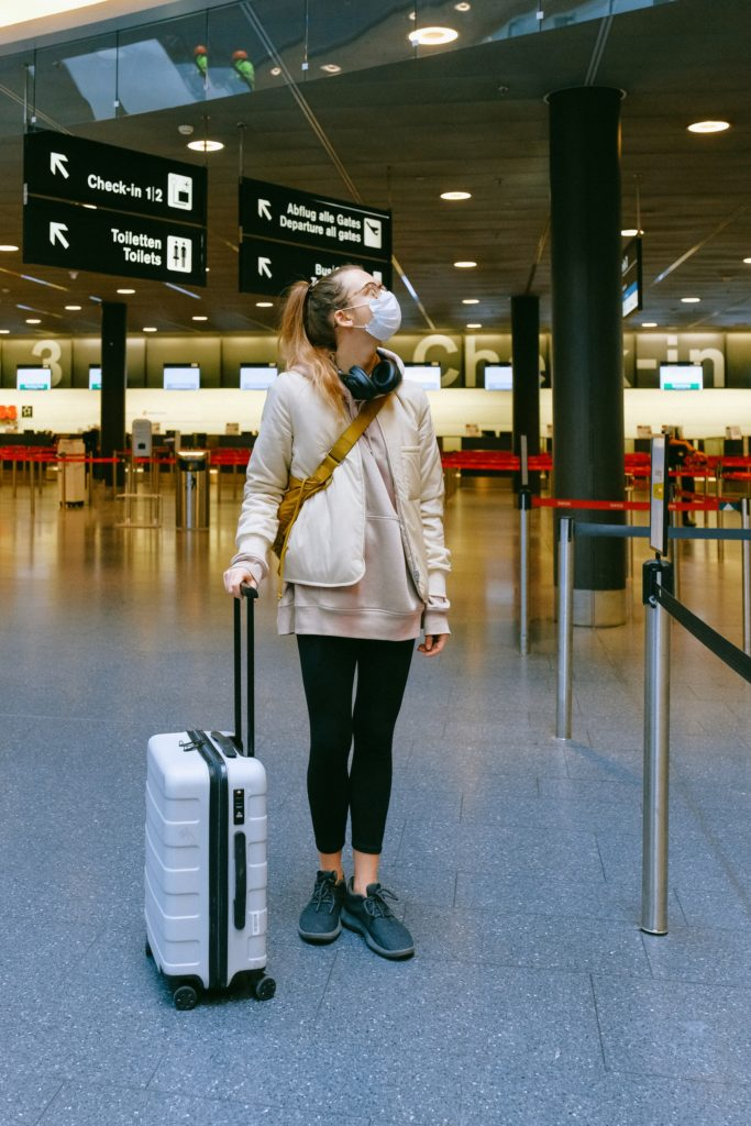 woman-wearing-face-mask-at-airport-3943883
